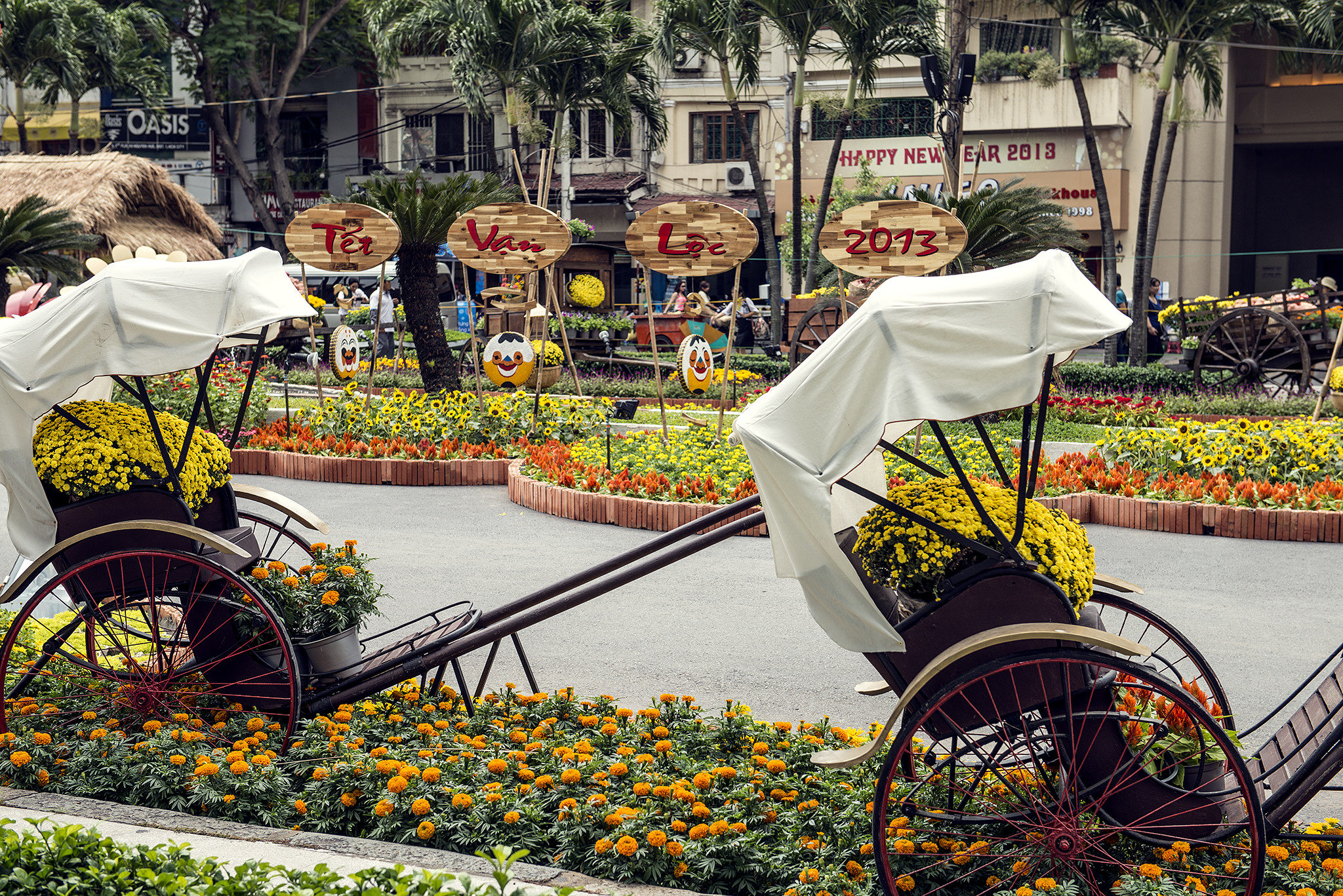 White-canopied traditional carts with yellow flowers